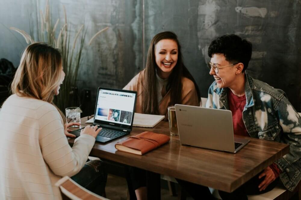 Collaborative work environments can help employees bond over common goals.